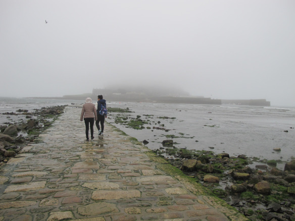 Irrelevant photo: The causeway to St. Michael's Mount, emerging as the tide drops. There's a castle out there, hidden in the fog.